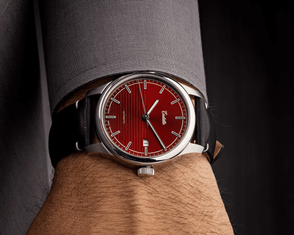 Wrist shot of our Swiss-made watch featuring a red dial and Eta 2824-2 automatic movement with a genuine leather strap