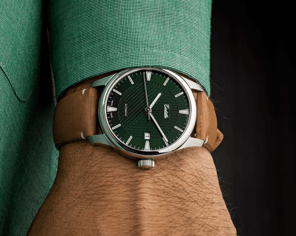 Wrist shot of our Swiss-made watch featuring a green dial and Eta 2824-2 automatic movement with a genuine leather strap