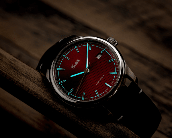 Swiss-made watch featuring a red dial and Eta 2824-2 automatic movement with a genuine leather strap and SuperLumiNova BGW9
