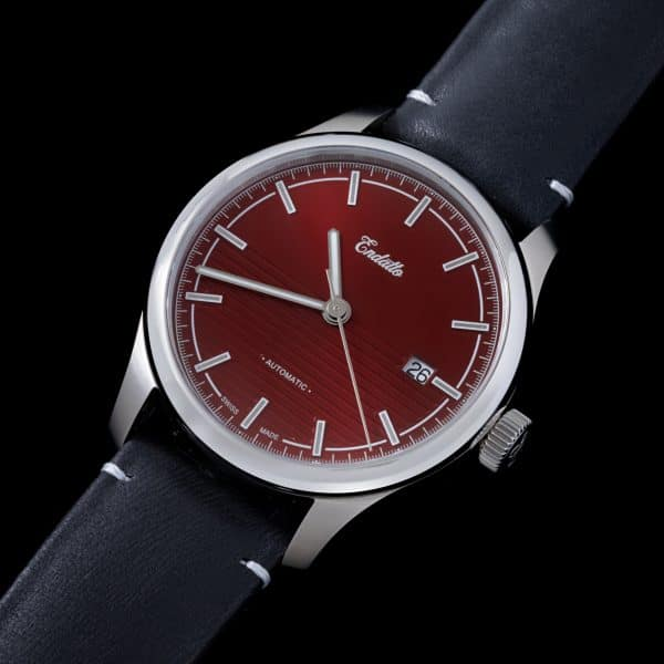 Swiss-made watch featuring a red dial and Eta 2824-2 automatic movement with a genuine leather strap