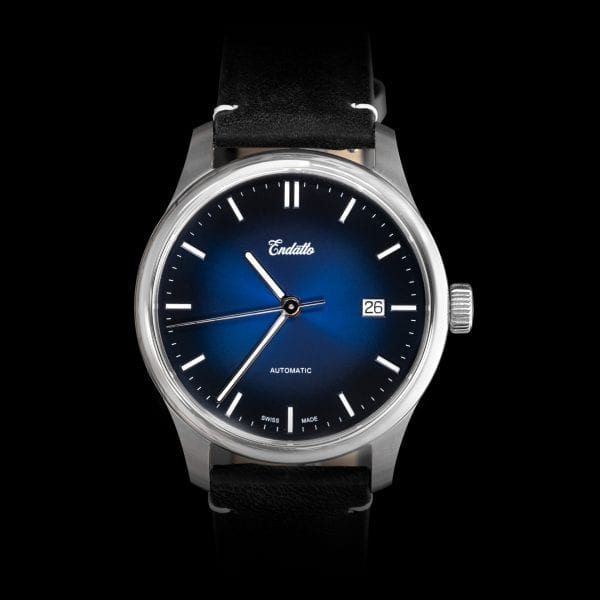 A swiss-made watch featuring an Eta 2824-2 automatic movement and a blue fume dial.