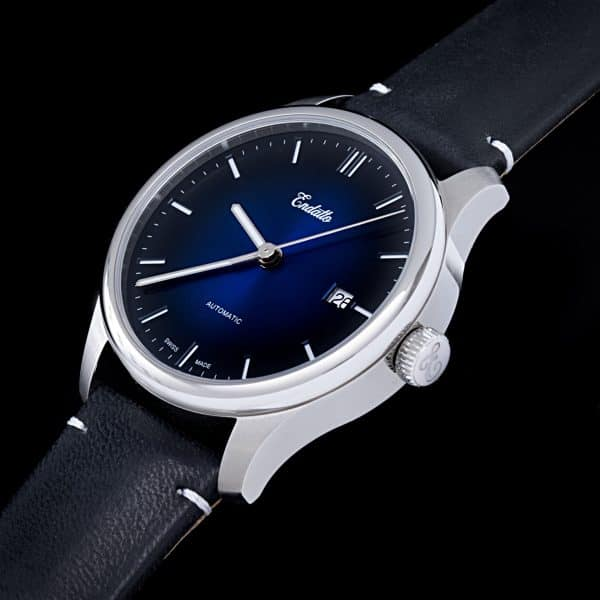 A swiss-made watch featuring an Eta 2824-2 automatic movement and a blue fume dial and engraved crown